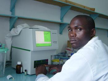Barnabas Lwila with CyFlow Counter at Bulongwa Lutheran Hospital