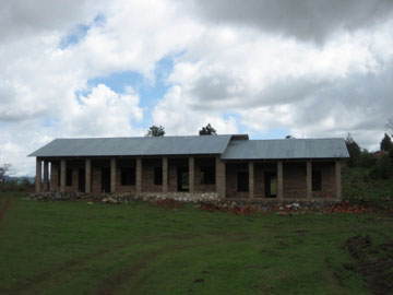 PIUMA's new care centre in Bulongwa. Fund-raising is underway for windows and electrical systems to complete the volunteer-built structure. Photo by Con Harrington