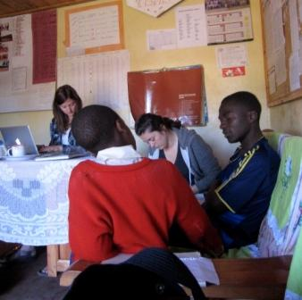 Kathryn Hansen, Ariane Desmarais-Michaud and George Sanga interview a student at Ramadani School in Njombe.
