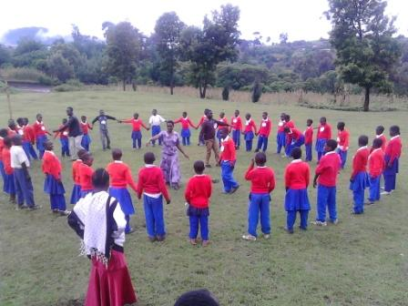 "YPHE Trainers and YPHE champions playing one of the games called ""TIM TIM TALALA"""