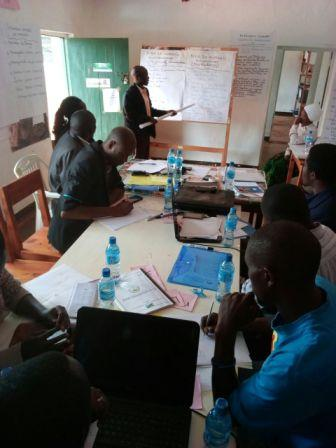 HHU team of volunteers in a discussion reviewing a program workplan